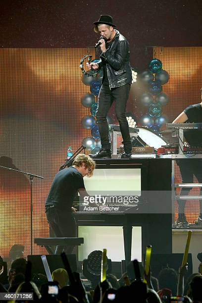 Recording artists Drew Brown and Ryan Tedder of music group OneRepublic perform onstage at 1013 KDWB's Jingle Ball 2014 presented by Sky Zone Indoor...