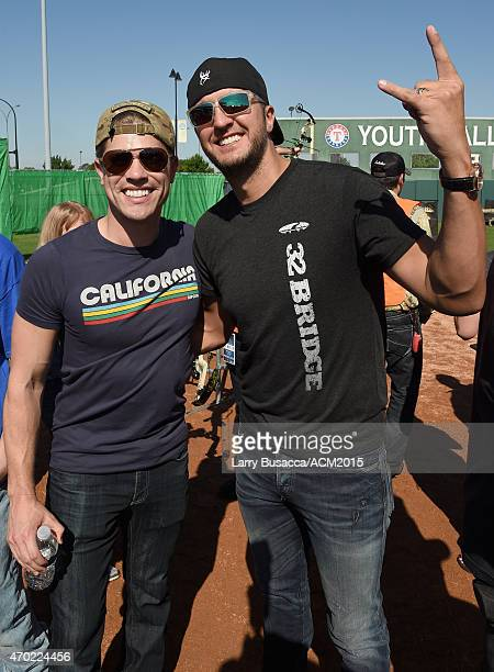 Recording artists Dustin Lynch and Luke Bryan attend the ACM Cabela's Great Outdoor Archery Event during the 50th Academy of Country Music Awards at...