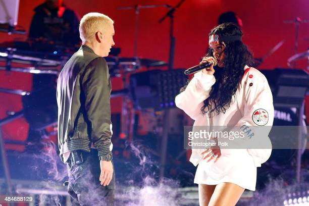 Recording artists Eminem and Rihanna perform onstage at the 2014 MTV Movie Awards at Nokia Theatre LA Live on April 13 2014 in Los Angeles California