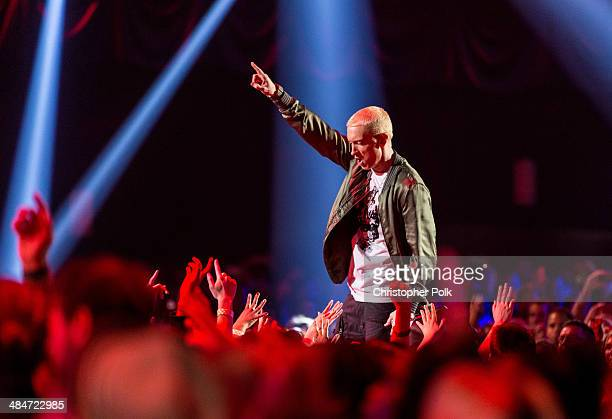 Recording artists Eminem performs onstage at the 2014 MTV Movie Awards at Nokia Theatre LA Live on April 13 2014 in Los Angeles California
