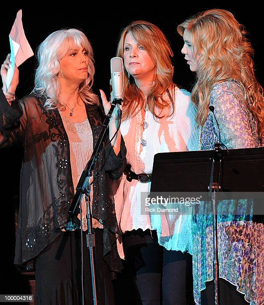 Recording Artists Emmylou Harris Patty Loveless and Alison Krauss perform during the Music Saves Mountains benefit concert at the Ryman Auditorium on...