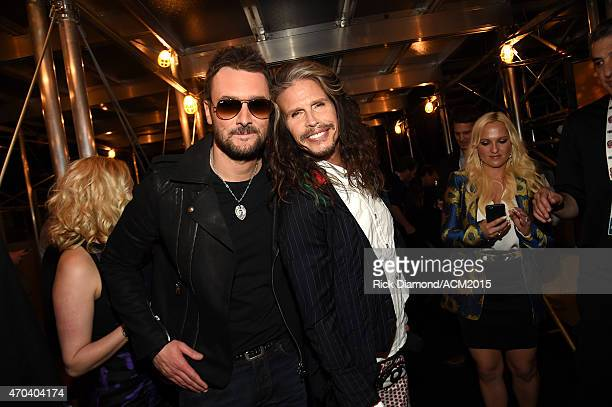 Recording artists Eric Church and Steven Tyler pose backstage during the 50th Academy of Country Music Awards at ATT Stadium on April 19 2015 in...