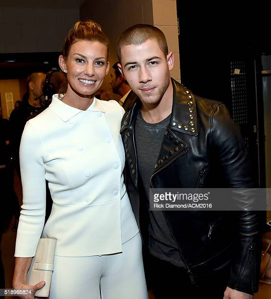 Recording artists Faith Hill and Nick Jonas attend the 51st Academy of Country Music Awards at MGM Grand Garden Arena on April 3 2016 in Las Vegas...