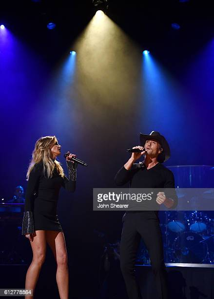 Recording artists Faith Hill left and Tim McGraw perform at the Ryman Auditorium during an announcement for their 'Soul2Soul World Tour' on October 4...