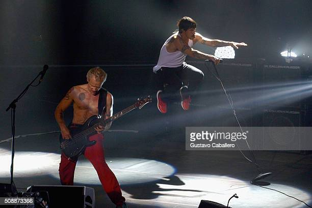 Recording artists Flea and Anthony Kiedis of Red Hot Chili Peppers perform onstage during the DirecTV and Pepsi Super Saturday Night featuring Red...