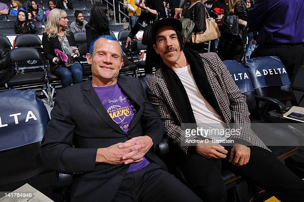 Recording artists Flea and Anthony Kiedis of the Red Hot Chili Peppers pose for a photograph before a game between the Portland Trail Blazers and the...