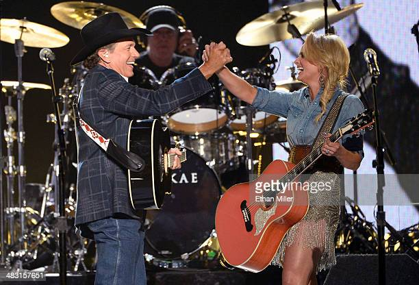 Recording artists George Strait and Miranda Lambert perform onstage during the 49th Annual Academy of Country Music Awards at the MGM Grand Garden...