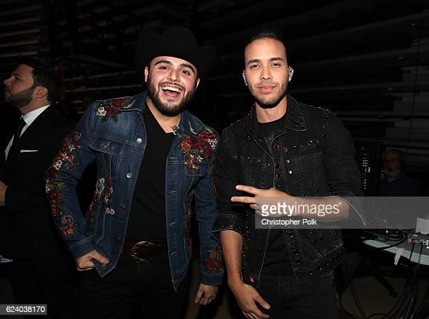 Recording artists Gerardo Ortiz and Prince Royce pose backstage at The 17th Annual Latin Grammy Awards at TMobile Arena on November 17 2016 in Las...
