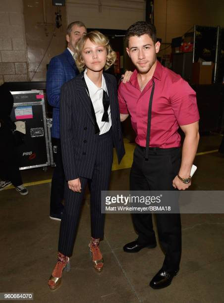 Recording artists Grace VanderWaal and Nick Jonas backstage at the 2018 Billboard Music Awards at MGM Grand Garden Arena on May 20 2018 in Las Vegas...