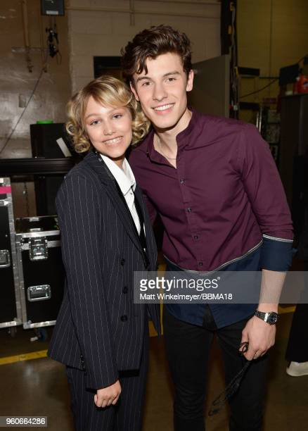 Recording artists Grace VanderWaal and Shawn Mendes backstage at the 2018 Billboard Music Awards at MGM Grand Garden Arena on May 20 2018 in Las...
