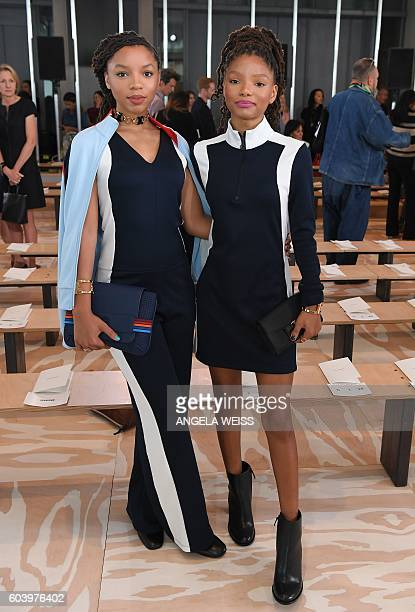 Recording artists Halle Bailey and Chloe Bailey of Chloe x Halle pose front row at the Tory Burch show during New York Fashion Week in New York on...