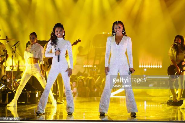 Recording artists Halle Bailey and Chloe Bailey of musical group Chloe X Halle perform onstage during the 2018 MTV Movie And TV Awards at Barker...