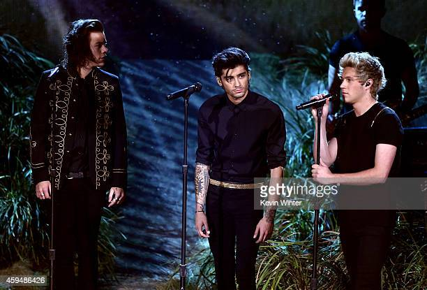 Recording artists Harry Styles Zayn Malik and Niall Horan of One Direction perform onstage at the 2014 American Music Awards at Nokia Theatre LA Live...