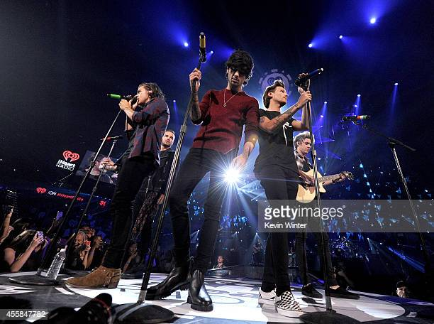Recording artists Harry Styles Zayn Malik Louis Tomlinson and Niall Horan of the music group One Direction perform onstage during the 2014...