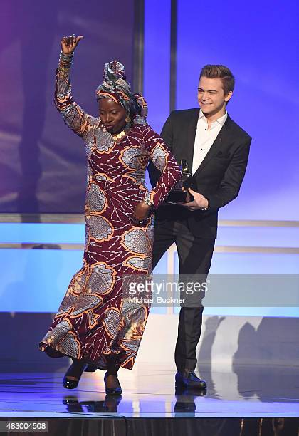 Recording artists Hunter Hayes and Angelique Kidjo appear onstage at the Premiere Ceremony during The 57th Annual GRAMMY Awards at the Nokia Theatre...