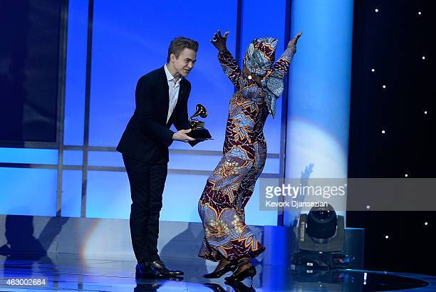 Recording artists Hunter Hayes and Angelique Kidjo appear onstage during the The 57th Annual GRAMMY Awards Premiere Ceremony at Nokia Theatre LA Live...