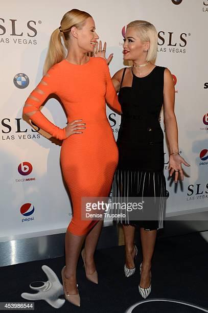 Recording artists Iggy Azalea and Rita Ora attend the SLS Las Vegas grand opening celebration on August 22 2014 in Las Vegas Nevada