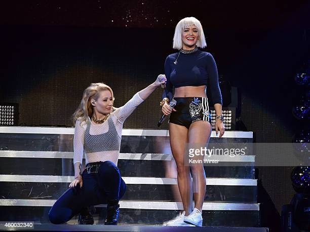 Recording artists Iggy Azalea and Rita Ora perform onstage during KIIS FM's Jingle Ball 2014 powered by LINE at Staples Center on December 5 2014 in...