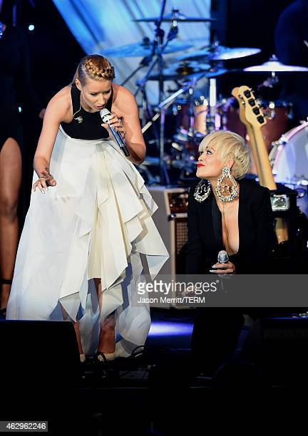 Recording artists Iggy Azalea and Rita Ora perform onstage during the PreGRAMMY Gala and Salute To Industry Icons honoring Martin Bandier at The...