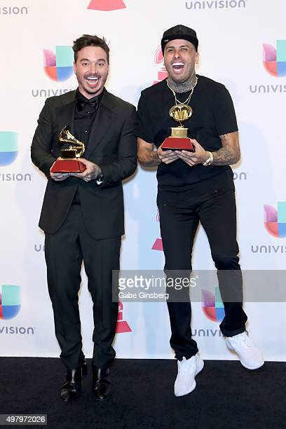 Recording artists J Balvin and Nicky Jam pose backstage with the award for the Best Urban Song 'Ay Vamos' in the press room during the 16th Latin...