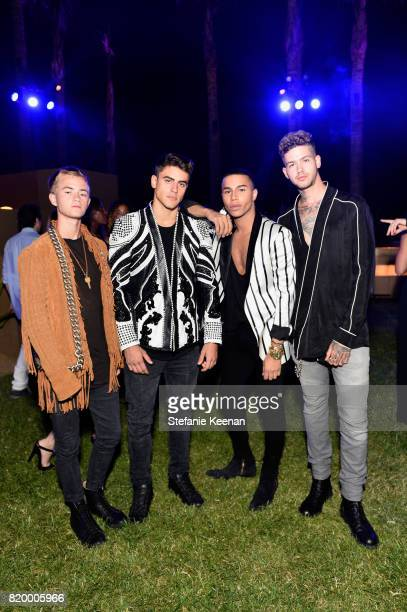 Recording Artists Jack Johnson Jack Gilinsky designer Olivier Rousteing and Travis Mills at BALMAIN celebrates first Los Angeles boutique opening and...