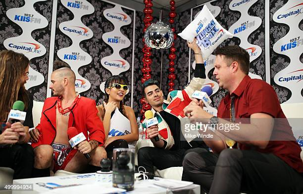 Recording artists Jack Lawless Cole Whittle JinJoo Lee and Joe Jonas of music group DNCE and radio personality Jesse Lozano attend 1027 KIIS FM's...