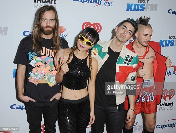 Recording artists Jack Lawless JinJoo Lee Joe Jonas and Cole Whittle of music group DNCE arrive at 1027 KIIS FM's Jingle Ball at Staples Center on...