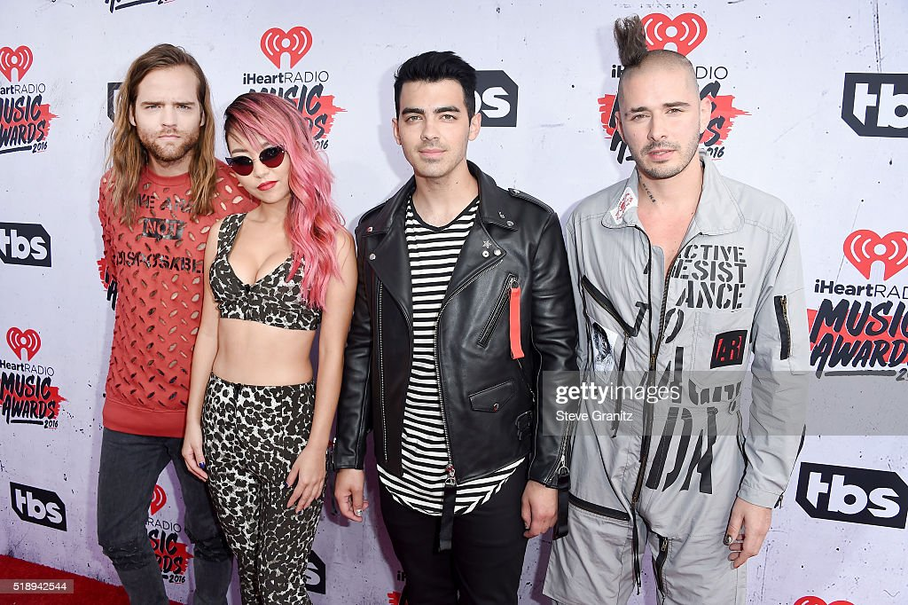 Recording artists Jack Lawless, JinJoo Lee, Joe Jonas and Cole Whittle of music group DNCE attend the iHeartRadio Music Awards at The Forum on April 3, 2016 in Inglewood, California.