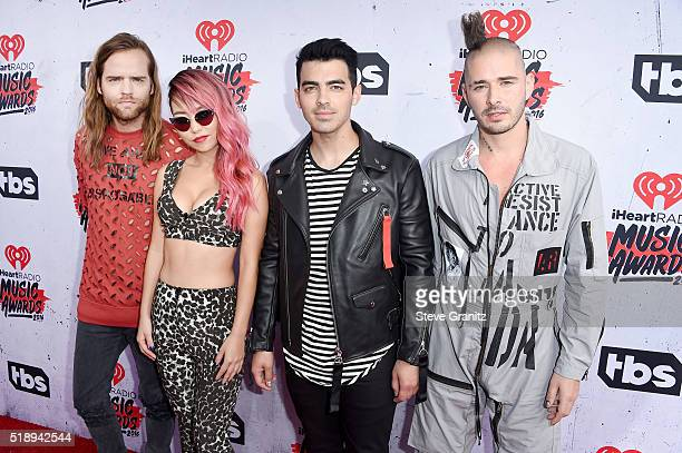 Recording artists Jack Lawless JinJoo Lee Joe Jonas and Cole Whittle of music group DNCE attend the iHeartRadio Music Awards at The Forum on April 3...