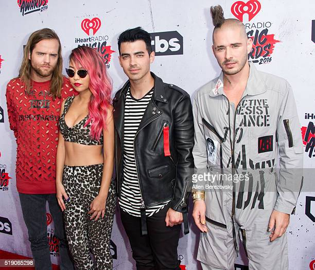 Recording artists Jack Lawless JinJoo Lee Joe Jonas and Cole Whittle of music group DNCE arrive at the iHeartRadio Music Awards at The Forum on April...
