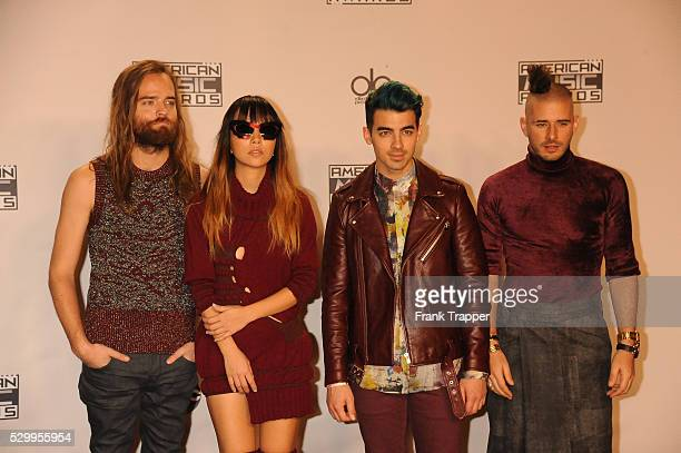 Recording artists Jack Lawless JinJoo Lee Joe Jonas and Cole Whittle of music group 'DNCE' pose at the 2015 American Music Awards held at the...