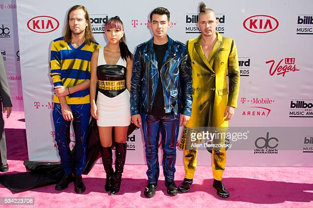 Recording artists Jack Lawless JinJoo Lee Joe Jonas and Cole Whittle of music group DNCE arrive at the 2016 Billboard Music Awards at TMobile Arena...
