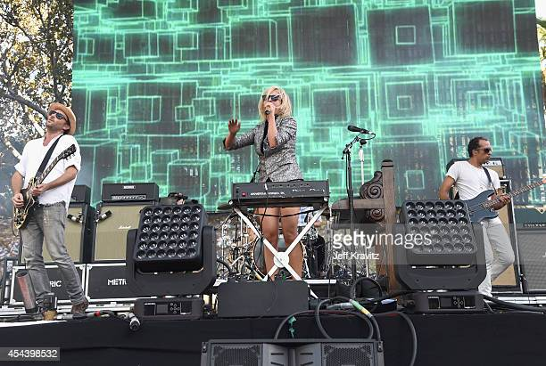Recording artists James Shaw Emily Haines and Joshua Winstead of Metric perform on the Dylan Stage during day 1 of the 2014 Budweiser Made in America...