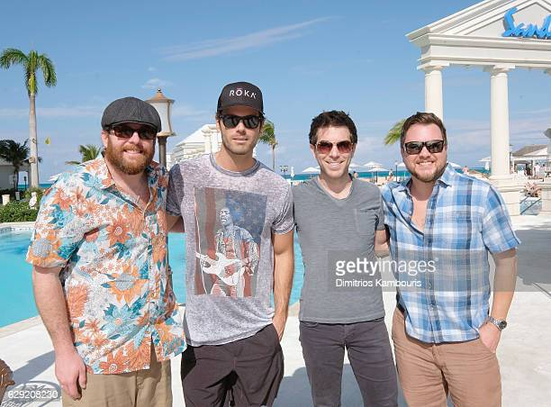 Recording artists James Young and Mike Eli of Eli Young Band pose with television personalities Chuck Wicks and Ty Bentli during CMT Story Behind The...