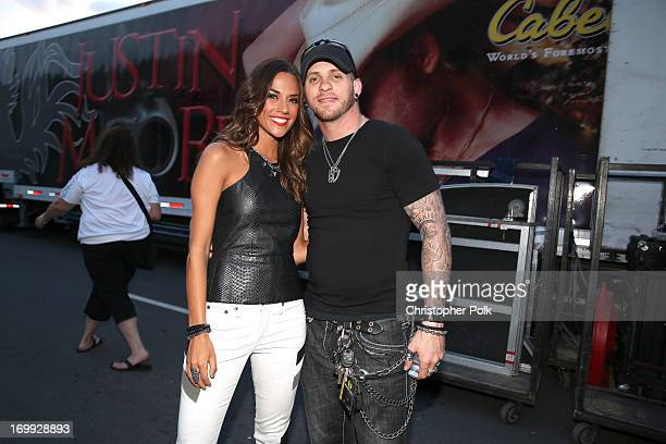 Recording artists Jana Kramer and Brantley Gilbert pose for a photo during Rodney Atkins' 3rd annual Music City Gives Back on June 4, 2013 in...