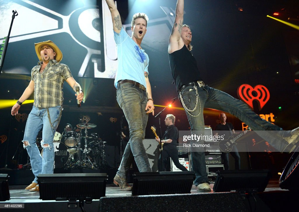 Recording artists Jason Aldean, Brian Kelley and Tyler Hubbard of Florida Georgia Line perform onstage during iHeartRadio Country Festival in Austin at the Frank Erwin Center on March 29, 2014 in Austin, Texas.
