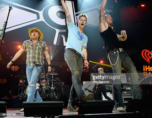 Recording artists Jason Aldean Brian Kelley and Tyler Hubbard of Florida Georgia Line perform onstage during iHeartRadio Country Festival in Austin...