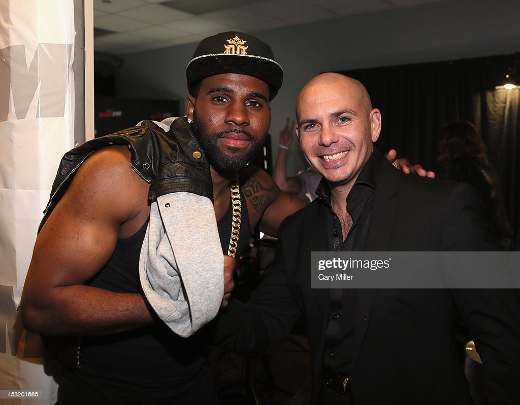 Recording artists Jason Derulo (L) and Pitbull pose backstage at 106.1 KISS FM's Jingle Ball 2013 American Airlines Center on December 2, 2013 in Dallas, Texas.