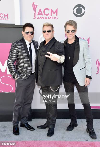Recording artists Jay DeMarcus Gary LeVox and Joe Don Rooney of music group Rascal Flatts attend the 52nd Academy Of Country Music Awards at Toshiba...