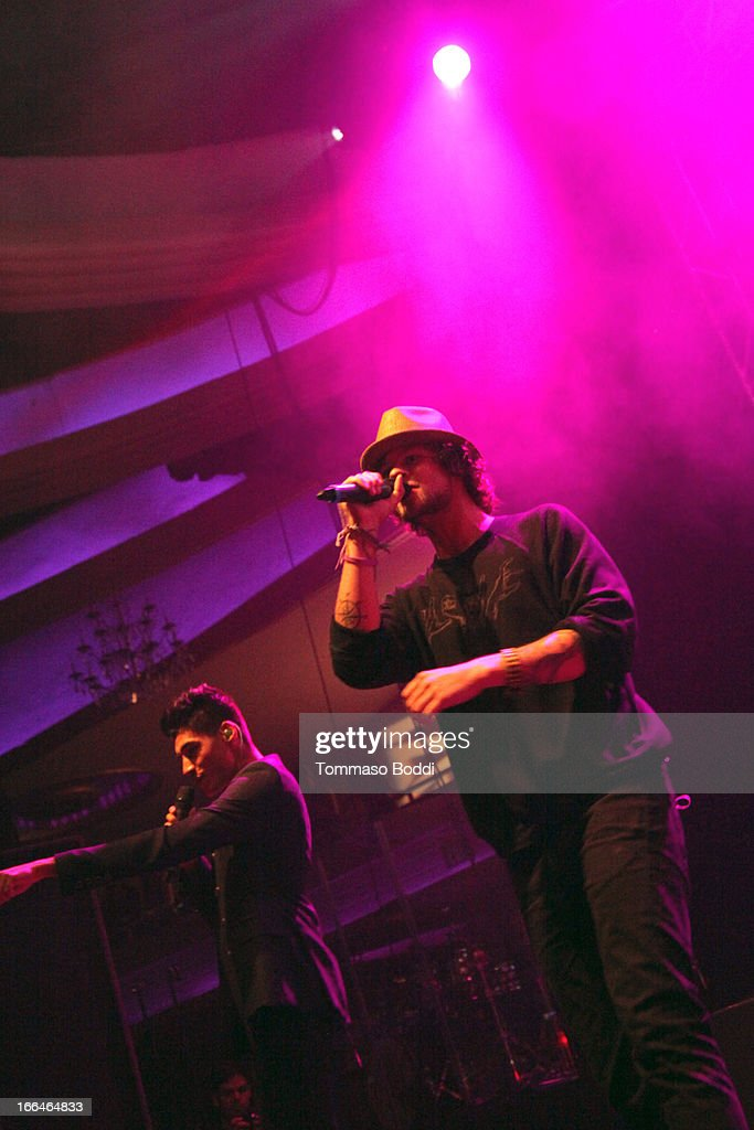 Recording artists Jay McGuiness (R) and Siva Kaneswaran of The Wanted perform at the 97.1 Amplify 2013 Concert held at The Hollywood Palladium on April 12, 2013 in Los Angeles, California.