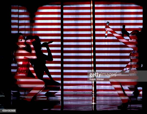 Recording artists Jennifer Lopez and Iggy Azalea perform onstage at the 2014 American Music Awards at Nokia Theatre LA Live on November 23 2014 in...