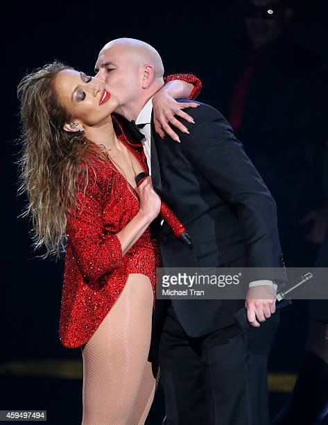 Recording artists Jennifer Lopez and Pitbull are seen onstage during the 2014 American Music Awards held at Nokia Theatre LA Live on November 23 2014...
