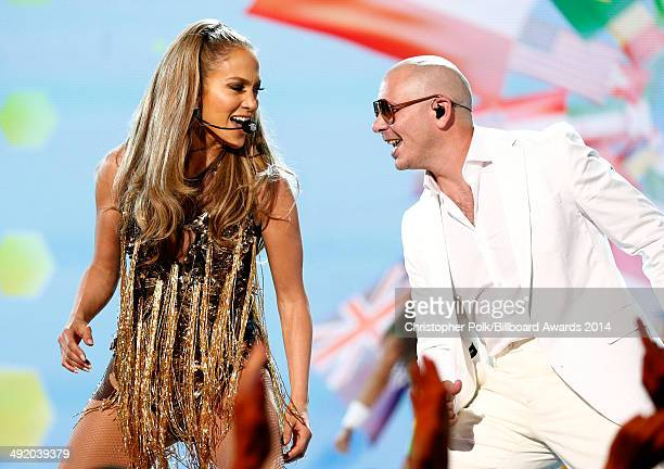 Recording artists Jennifer Lopez and Pitbull perform onstage during the 2014 Billboard Music Awards at the MGM Grand Garden Arena on May 18 2014 in...