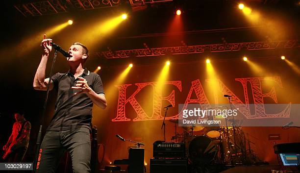 Recording artists Jesse Quin Tom Chaplin and Richard Hughes of Keane perform on stage at the Greek Theatre on July 21 2010 in Los Angeles California