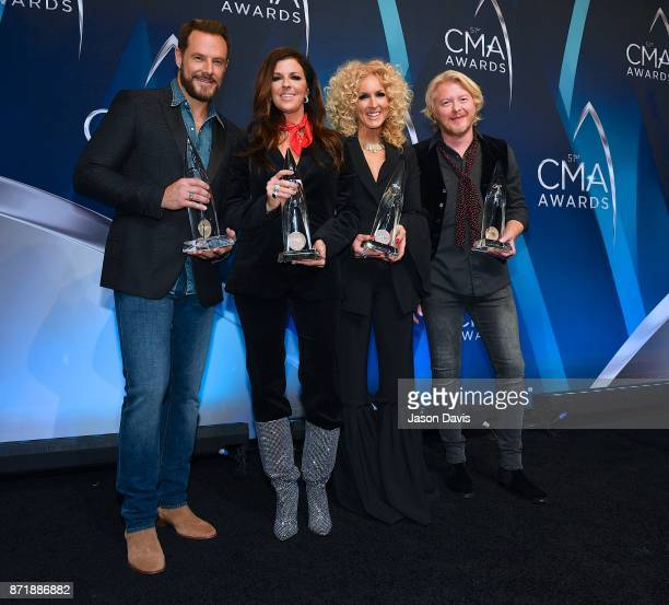 Recording Artists Jimi Westbrook Karen Fairchild Kimberly Schlapman and Phillip Sweet of Little Big Town celebrate winning Vocal Group of the Year...