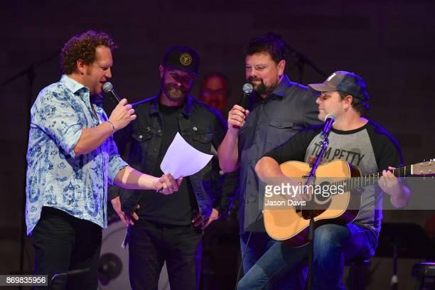Recording Artists Joe Denim and Dierks Bentley SiriusXM Host Storme Warren and Recording Artist Rhett Akins look over song notes during Nashville...