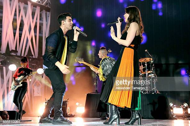 Recording artists Joe Jonas and Hailee Steinfeld and perform on stage with DNCE during 2016 iHeartRadio Summer Pool Party at Fountainbleau Miami...