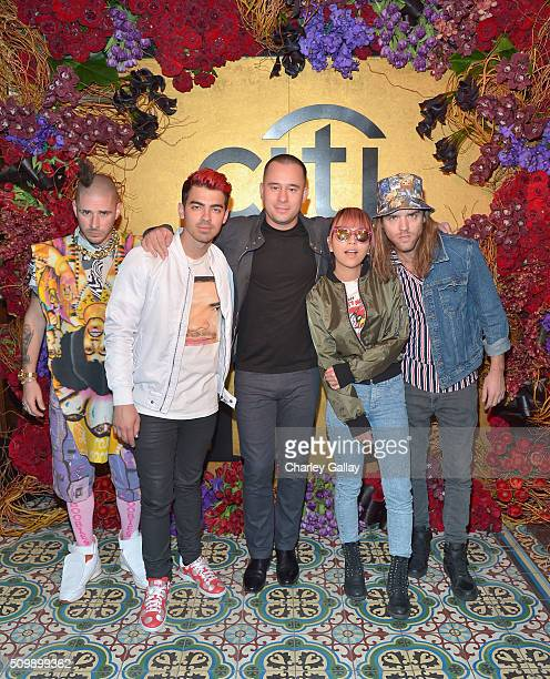 Recording artists Joe Jonas Cole Whittle manager Phil McIntyre JinJoo Lee and Jack Lawless of DNCE attend the Citi Celebrates 2016 Billboard Power...