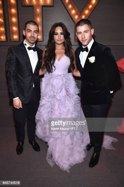 Recording artists Joe Jonas Demi Lovato and Nick Jonas attend the 2017 Vanity Fair Oscar Party hosted by Graydon Carter at Wallis Annenberg Center...