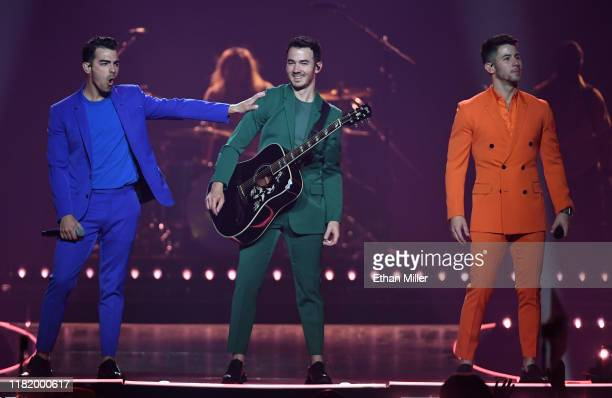 Recording artists Joe Jonas Kevin Jonas and Nick Jonas of Jonas Brothers perform during a stop of the group's Happiness Begins Tour at MGM Grand...